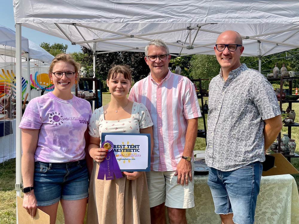 Norah Amstutz - Best Tent Aesthetic - Arts on the Millrace 2021 - Pictured with judges Jennifer Beachy, Tim Shelly, and David Kendall
